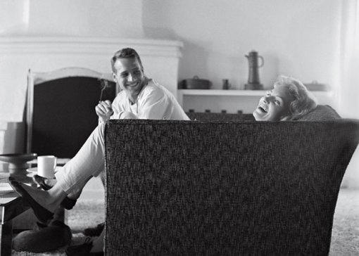 Newman and actress Joanne Woodward share a laugh in their Beverly Hills home in 1958, the year they were married. By Sid Avery/MPTV.net