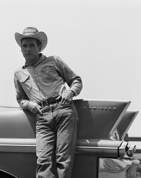 In character as rancher Hud Bannon, Newman leans against the tail fin of a pink 1958 Cadillac during the filming of Martin Ritt's 1963 classic, Hud. By Bradley Smith/Corbis.
