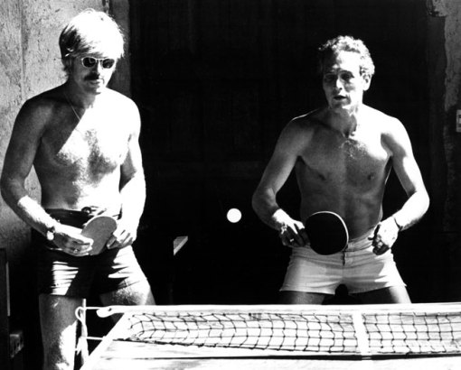 Taking a break on the set of Butch Cassidy and the Sundance Kid, Newman plays ping-pong with co-star Robert Redford, 1969. From the Everett Collection.