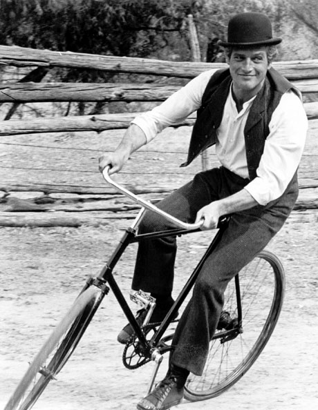 Newman in character as bicycle-riding rogue Butch Cassidy. From Twentieth Century Fox Film Corp./Photofest.