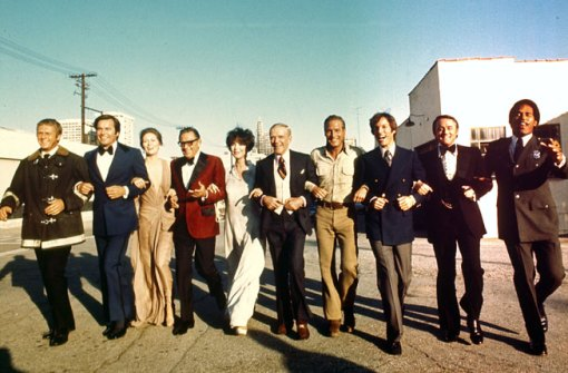 The star-studded cast of the 1974 film The Towering Inferno included, from left, Steve McQueen, Robert Wagner, Faye Dunaway, William Holden, Jennifer Jones, Fred Astaire, Newman, Richard Chamberlain, Robert Vaughn, and O. J. Simpson. From Twentieth Century Fox Film Corp./Photofest.