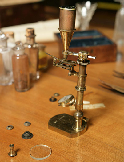 One of Darwin's original microscopes is just one of the many personal items on display in this elaborate reproduction of Darwin's study from Down House.
